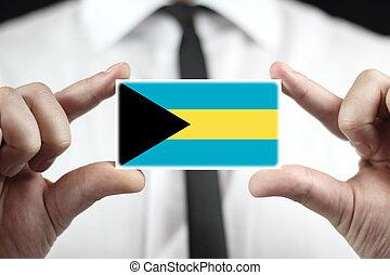 Businessman holding a business card with Bahamas Flag