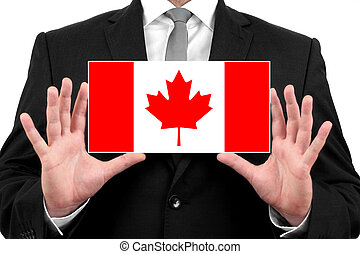 Businessman holding a business card with Canada Flag