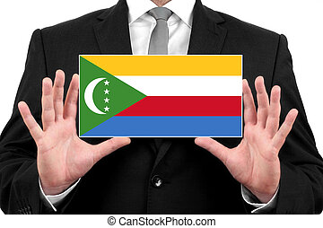 Businessman holding a business card with Comoros Flag