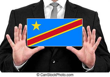 Businessman holding a business card with Democratic Republic of the Congo Flag