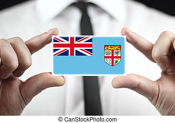 Businessman holding a business card with Fiji Flag