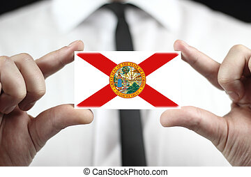 Businessman holding a business card with Florida Flag