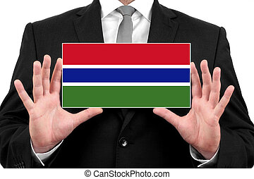 Businessman holding a business card with Gambia Flag