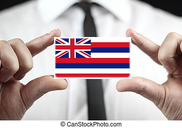 Businessman holding a business card with Hawaii Flag
