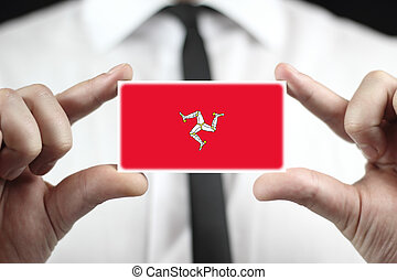 Businessman holding a business card with Isle of Man Flag