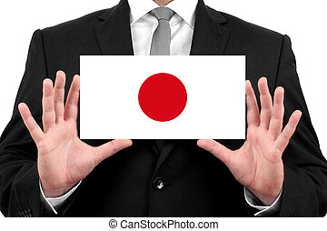 Businessman holding a business card with Japan Flag