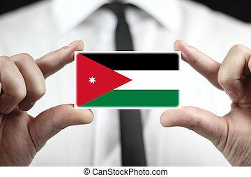 Businessman holding a business card with Jordan Flag