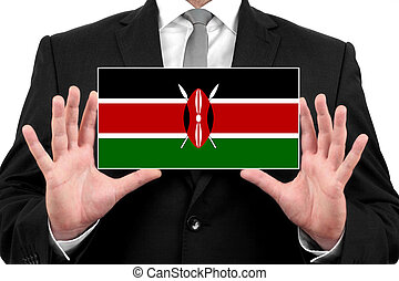 Businessman holding a business card with Kenya Flag