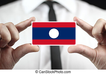 Businessman holding a business card with Laos Flag