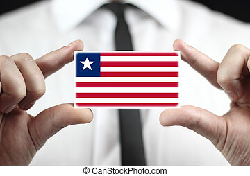 Businessman holding a business card with Liberia Flag