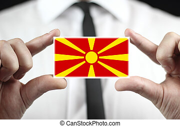 Businessman holding a business card with Macedonia Flag