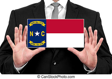 Businessman holding a business card with North Carolina ...