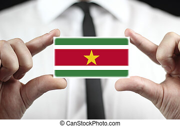 Businessman holding a business card with Suriname Flag