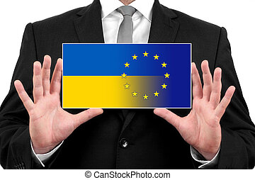 Businessman holding a business card with Ukraine and EU Flag