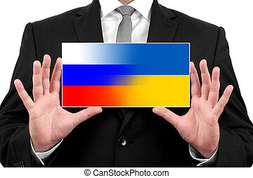 Businessman holding a business card with Ukraine and Russia Flag