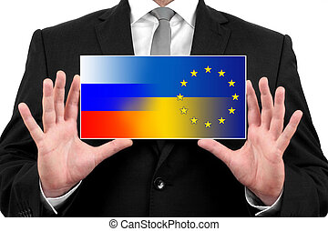 Businessman holding a business card with Ukraine, EU and Russia Flag