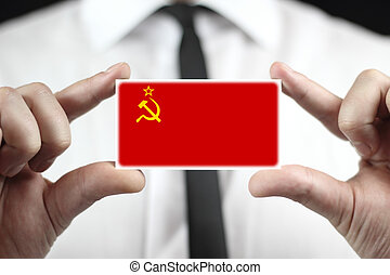 Businessman holding a business card with USSR Flag