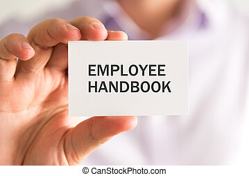 Businessman holding a card with EMPLOYEE HANDBOOK message -...