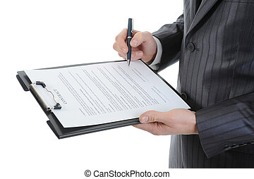 clipboard - Businessman holding a clipboard signs contract....