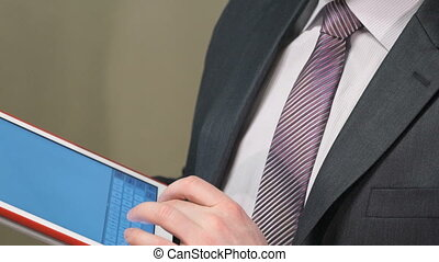 Businessman holding a digital tablet