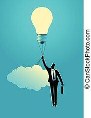Businessman holding a floating light bulb