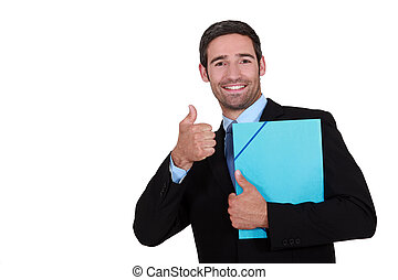 Businessman holding a folder and giving the thumb's up