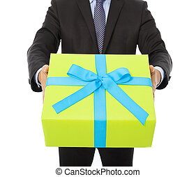 Businessman holding a gift. isolated on white