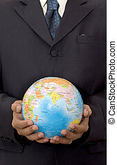 Businessman holding a globe 3D puzzle
