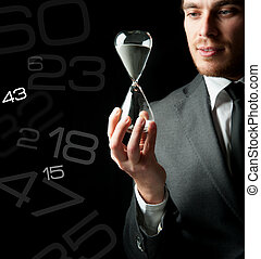 Businessman holding a hourglass with a girl inside
