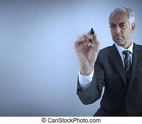 Businessman holding a marker