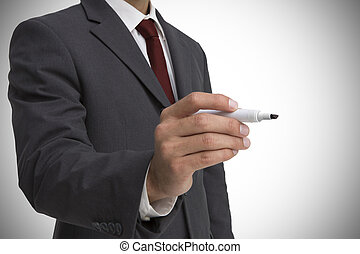 Businessman holding a marker