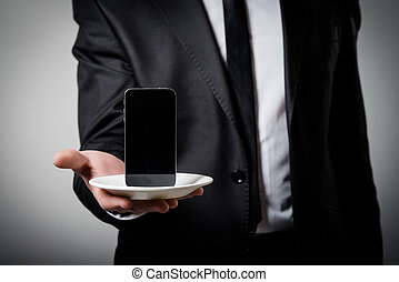 businessman holding a phone in his hand