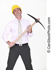 businessman holding a pickax