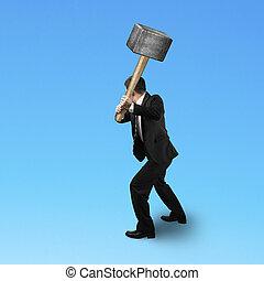 Businessman holding a sedge hammer in blue background