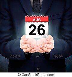 businessman holding a small calendar