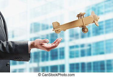 Startup working enterprise - Businessman holding a small...