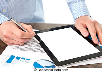 businessman holding a tablet computer with isolated screen on the table with graphics