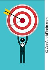 Businessman holding a target with arrow