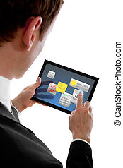 businessman holding a touchpad pc using little widget...