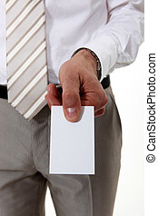 businessman holding a visit card
