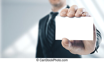 Businessman holding a white business card