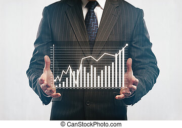 Businessman holding abstract business diagram