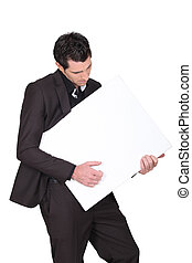 businessman holding an advertising board