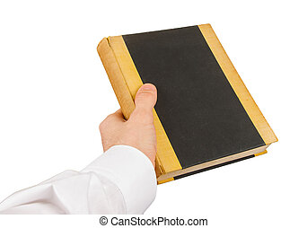 Businessman holding an old book