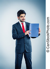businessman holding application folder isolated