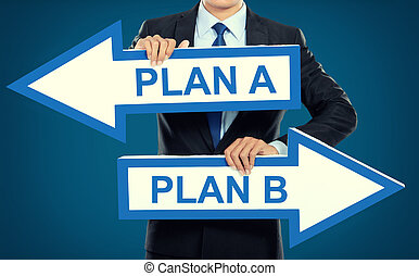 Businessman holding arrow in hand, Plan concept