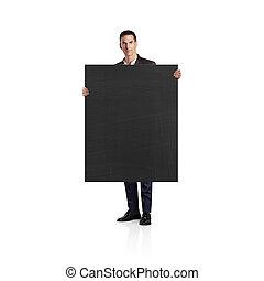 Businessman holding blackboard. Isolated on white