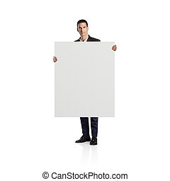 Businessman holding blank canvas. Isolated on white