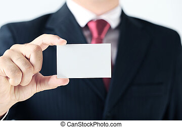 Businessman holding blank card in his hand