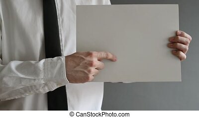 Businessman holding blank paper with copy space for business...